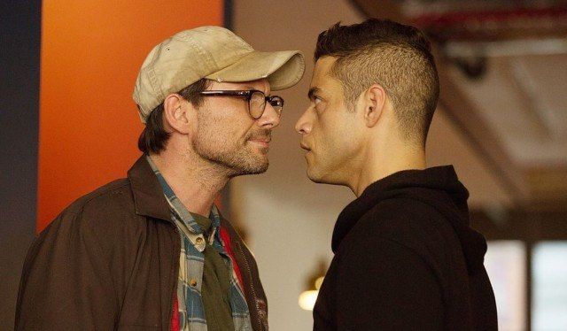 Mr. Robot and Elliot staring each other down.