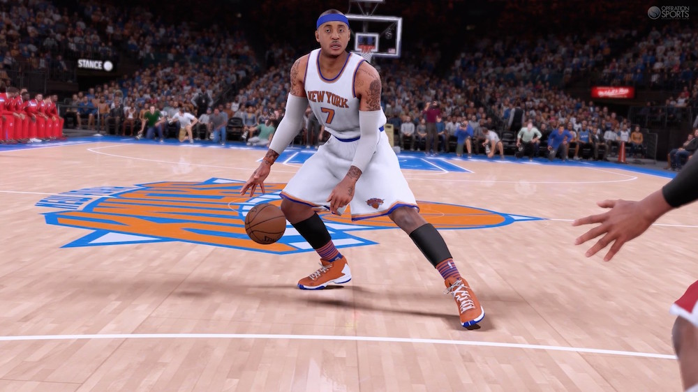 A basketball player dribbles up to the basket in NBA 2K16