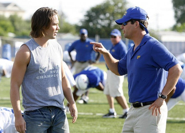 Tim Riggins (Taylor Kitsch) and Coach Taylor (Kyle Chandler) get into it on the field in a scene from 'Friday Night Lights' actors