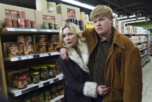 Jesse Plemons is leaning on Kirsten Dunst as they walk through a store in Fargo.