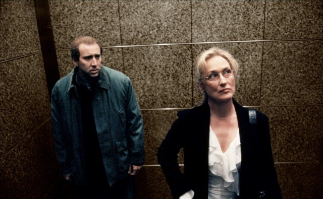 Charlie Kaufman (Nicholas Cage) and Susan Orlean (Meryl Streep) stand in an elevator in a scene from the Oscar-winning film 'Adaptation.' actors