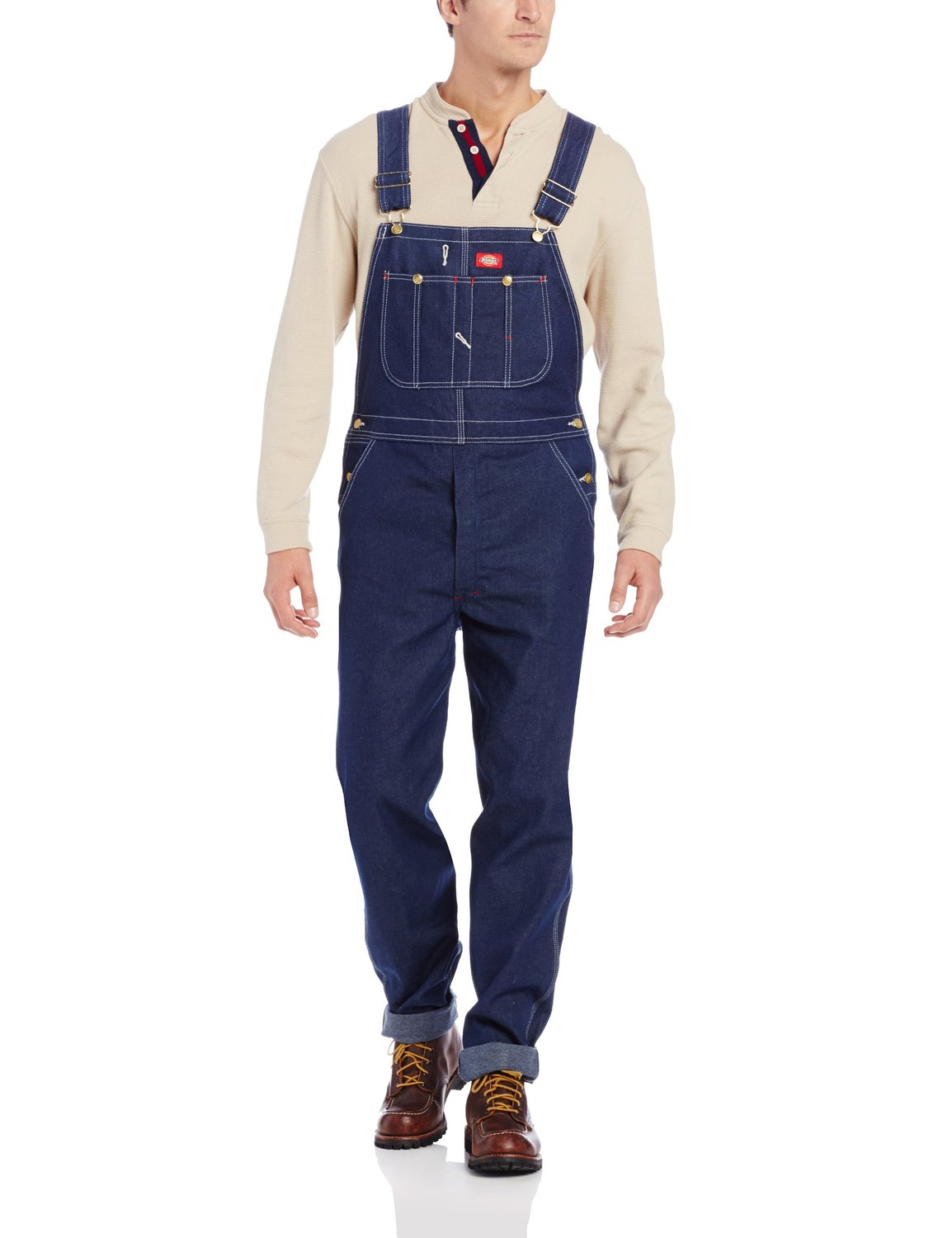 A man wears his overalls.