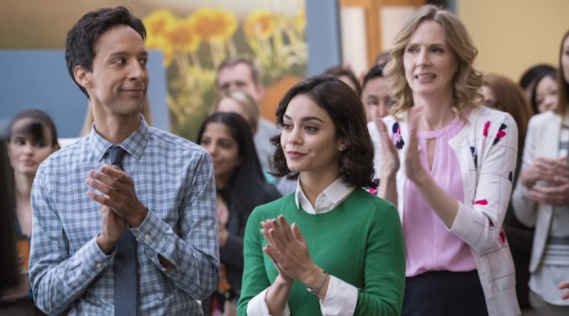 Vanessa Hudgens, Danny Pudi, and Christina Kirk clap their hands in a scene from Powerless