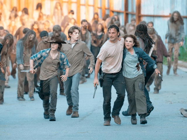 "Carl (Chandler Riggs), Ron (Austin Abrams), Rick (Andrew Lincoln) and Deanna (Tovah Feldshuh) try to escape the horde of walkers on their way to Alexandria in a scene from 'The Walking Dead' midseason finale, ""Start to Finish."""