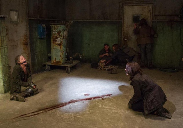 "Carol (Melissa McBride) and Maggie (Lauren Cohen) sit on the Saviors' kill floor in a scene from 'The Walking Dead' episode ""The Same Boat."""