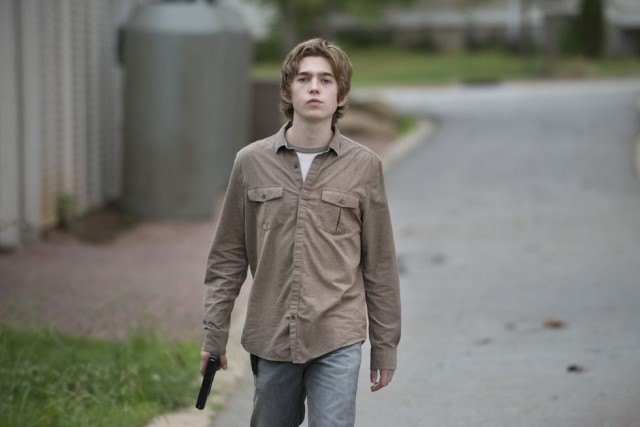"Ron (Austin Abrams) carries a gun as he pursues vengeance against Rick and Carl in a scene from the sixth season 'Walking Dead' episode, ""Start to Finish."""