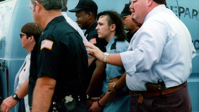 Teenager and accused murderer Damien Echols is escorted into court in a scene from 'Paradise Lost: The Child Murders at Robin Hood Hills', documentaries