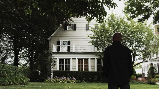 Daniel Lutz stands in front of his childhood home in a scene from the documentary 'My Amityville Horror' documentaries