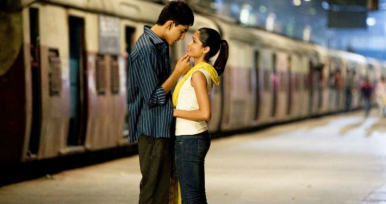 Jamal and Latika looking into each other's eyes in Slumdog Millionaire