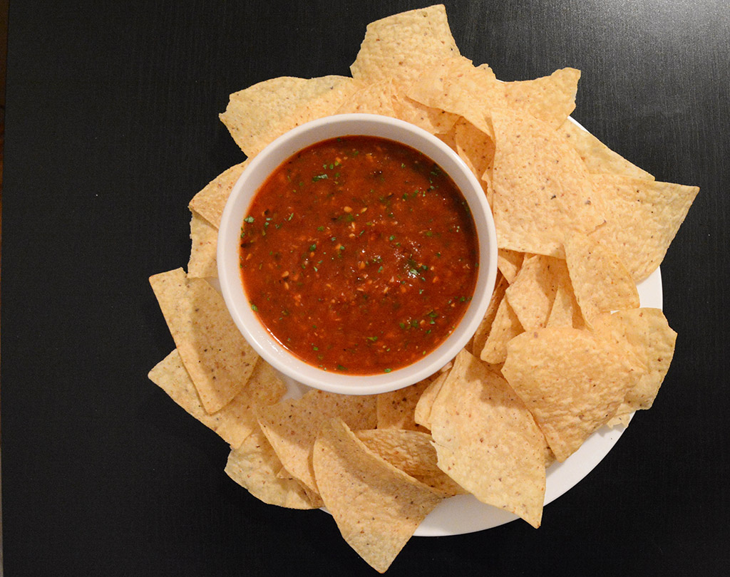 smoky tomato salsa with tortilla chips is a quick appetizer