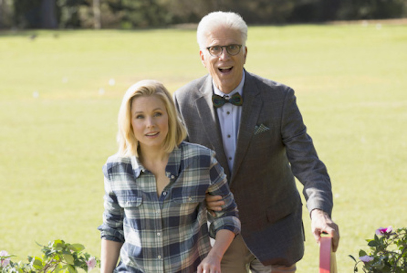 Kristen Bell and Ted Danson walk together in the pilot episode of NBC's The Good Place