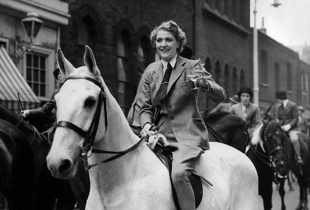 woman on horse drinking champagne