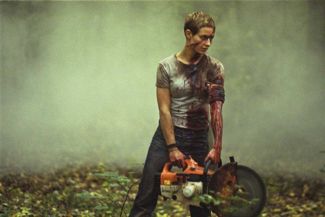 Marie (Cecile de France) stands with a buzzsaw in a scene from the French horror movie 'High Tension.'