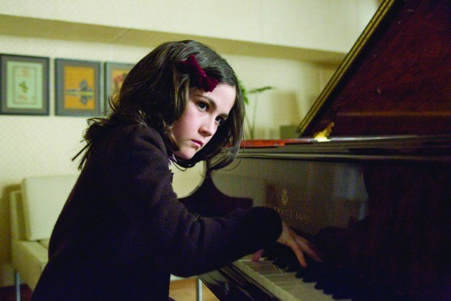 Esther (Isabelle Fuhrman) plays the piano in a scene from 'Orphan'