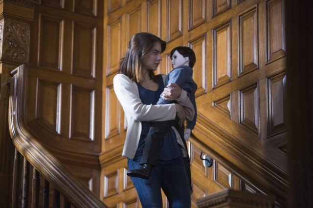 Greta (Lauren Cohan) carries Brahms the doll down the stairs in a scene from 'The Boy.'