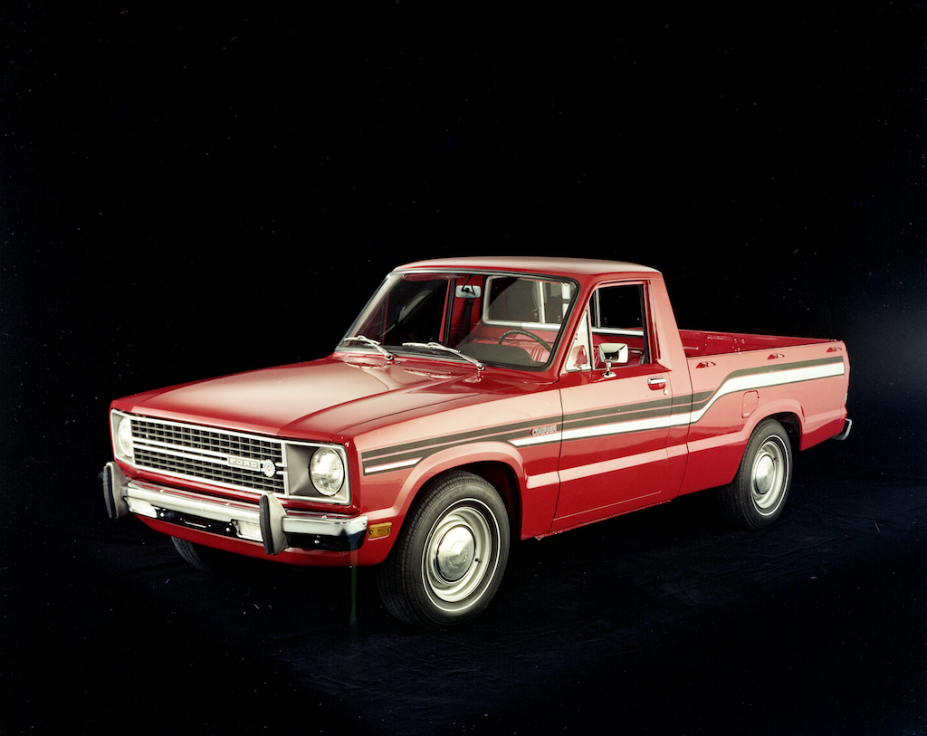 A red 1976 Ford Courier truck