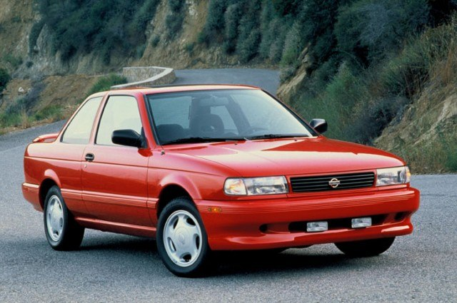 A red Nissan Sentra SE-R from the early 1990s.