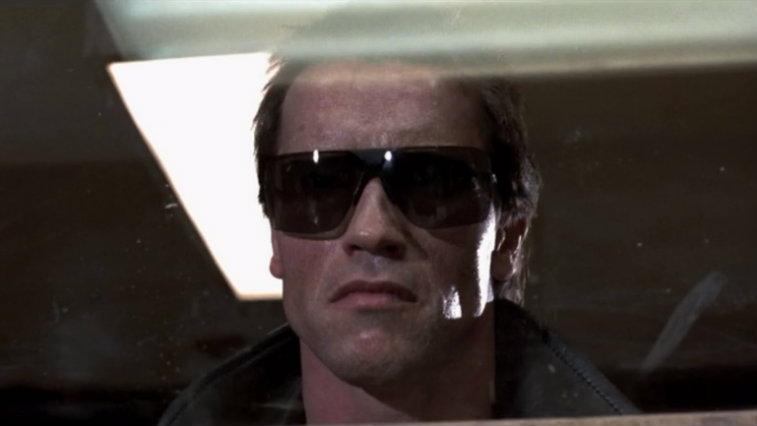 Arnold Schwarzenegger wearing sunglasses in The Terminator.