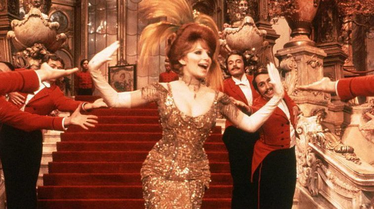 Barbra Streisand dances in evening wear in Hello Dolly