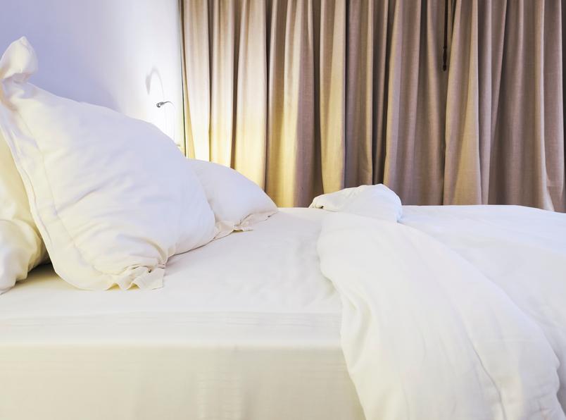 Bed sheet and pillow on mattress