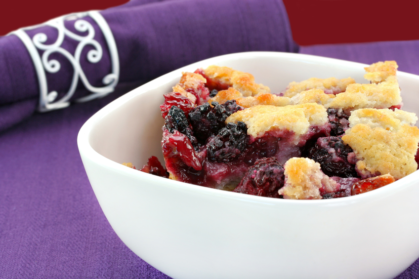 Berry cobbler in a white bowl