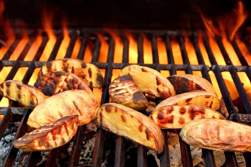 Big Slice Of Potatoes On Hot BBQ Grill