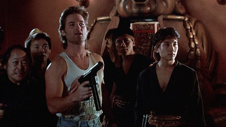 Kurt Russell and several men dressed as ninjas in Big Trouble in Little China