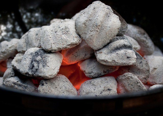 close-up of a pile of burning charcoal in a grill