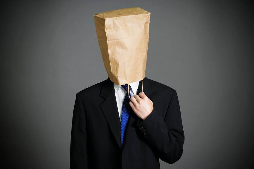 Businessman wearing paper bag on face