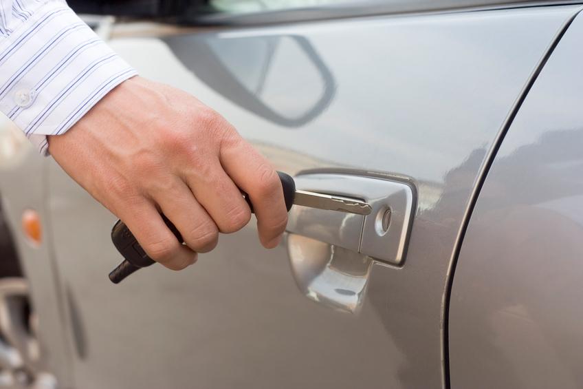 man inserting car key into lock hole, car product testing
