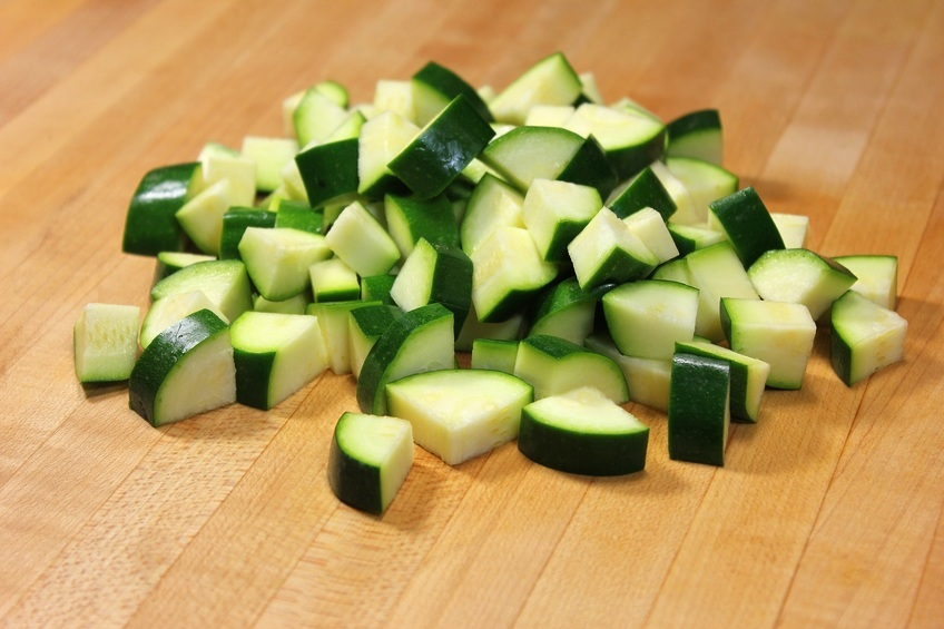 Chopped Zucchini on wooden board