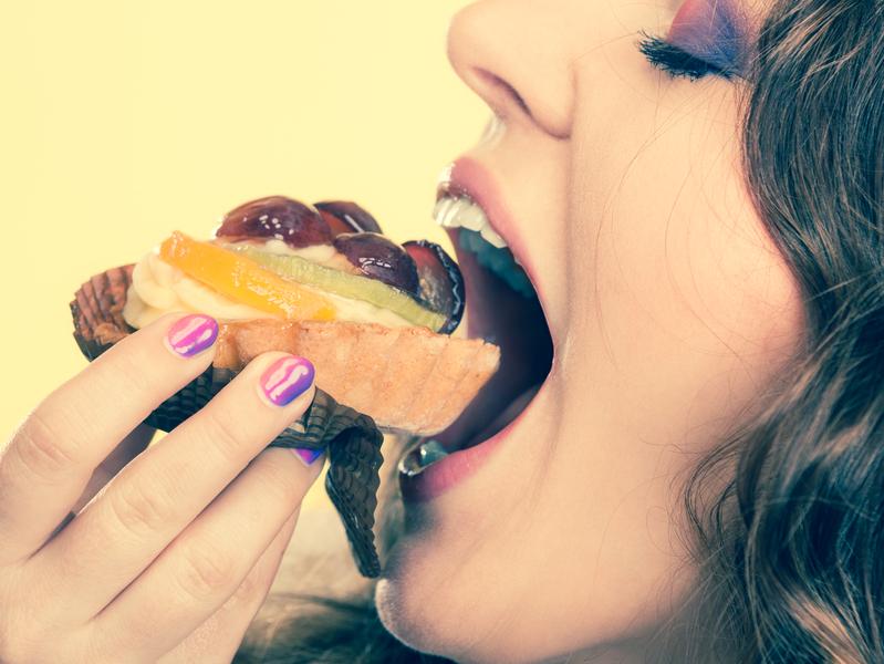 woman eating fruit cake