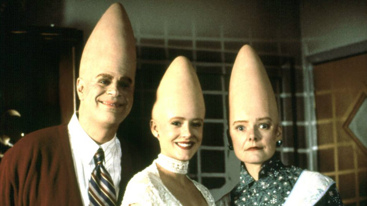 Dan Aykroyd, Michelle Burke, and Jane Curtain pose next to each other in Coneheads