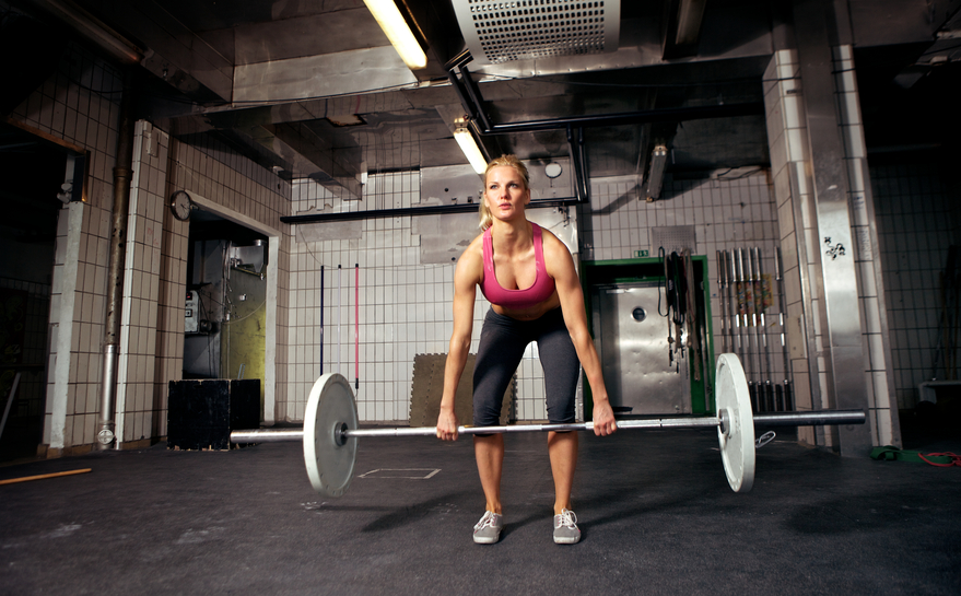 A woman prepares to deadlift