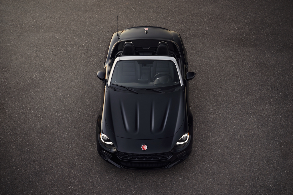 Aerial view of a black Fiat 124 Spider.