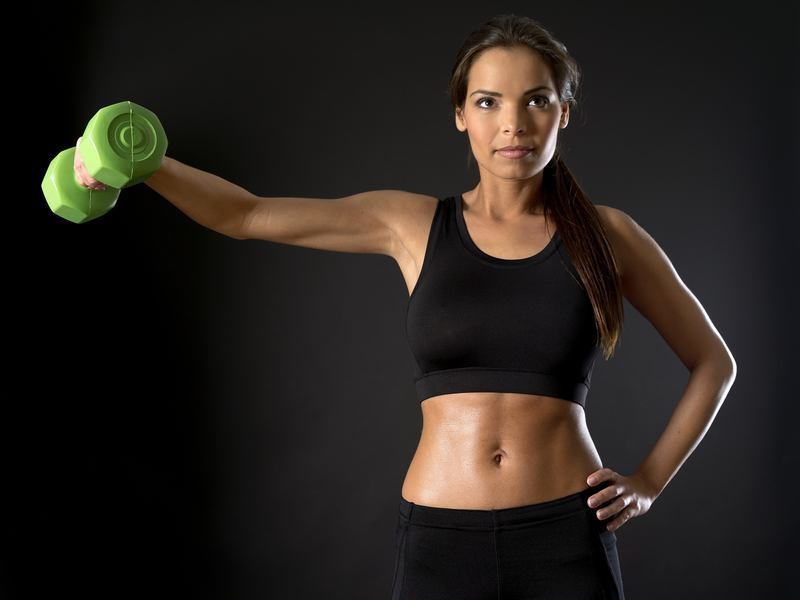 A woman doing side shoulder fly exercise