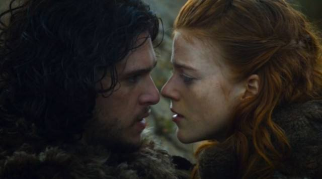 Jon Snow (Kit Harington) and Ygritte (Rose Leslie) share a romantic moment in a scene from 'Game of Thrones'