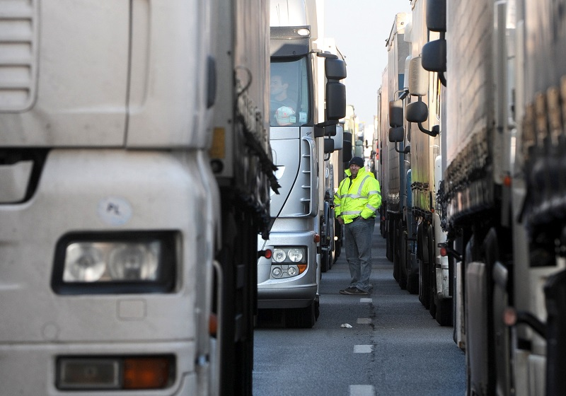 A truck driver waiting in line