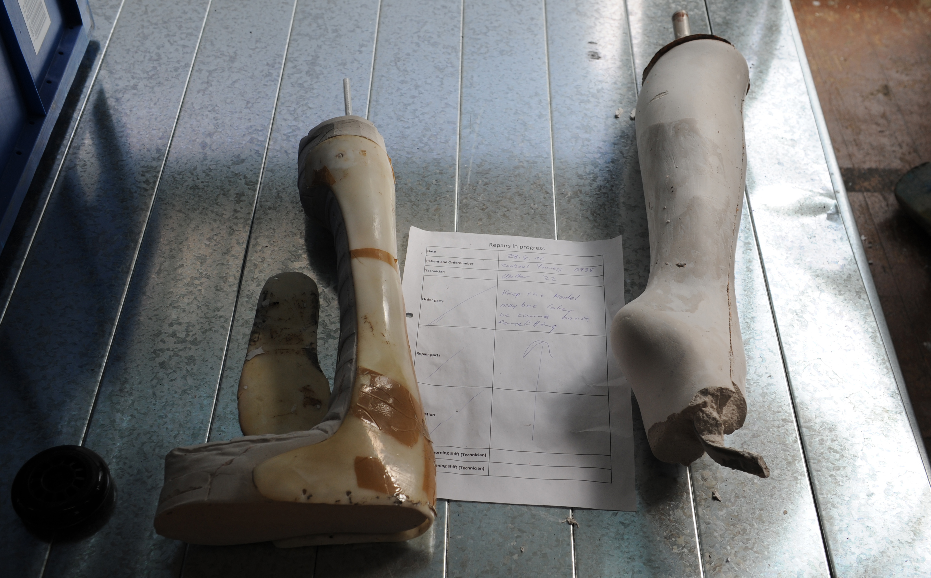 Repairs on athletes' prosthetic limbs are carried out in a workshop