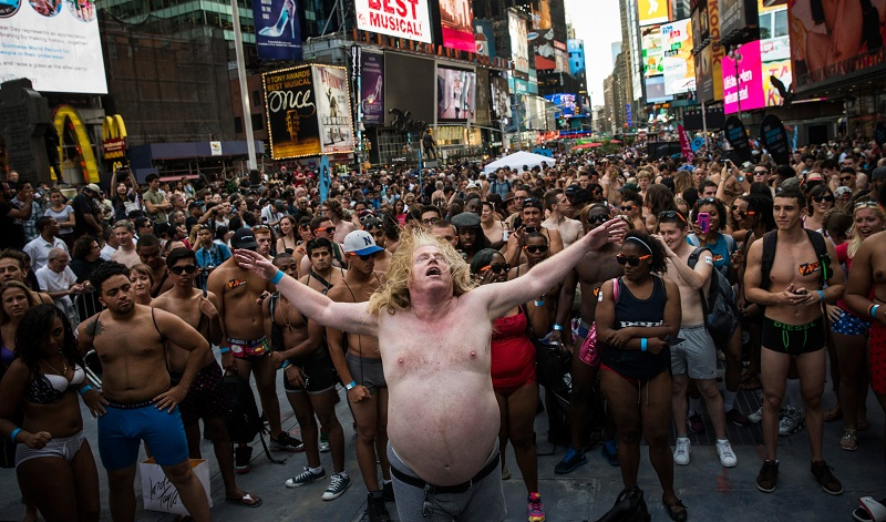 A large man in large undies dances in times square