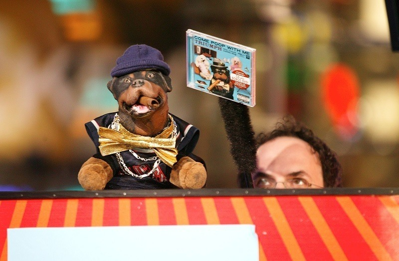 Triumph the Insult Comic Dog appears on stage with Robert Smigel