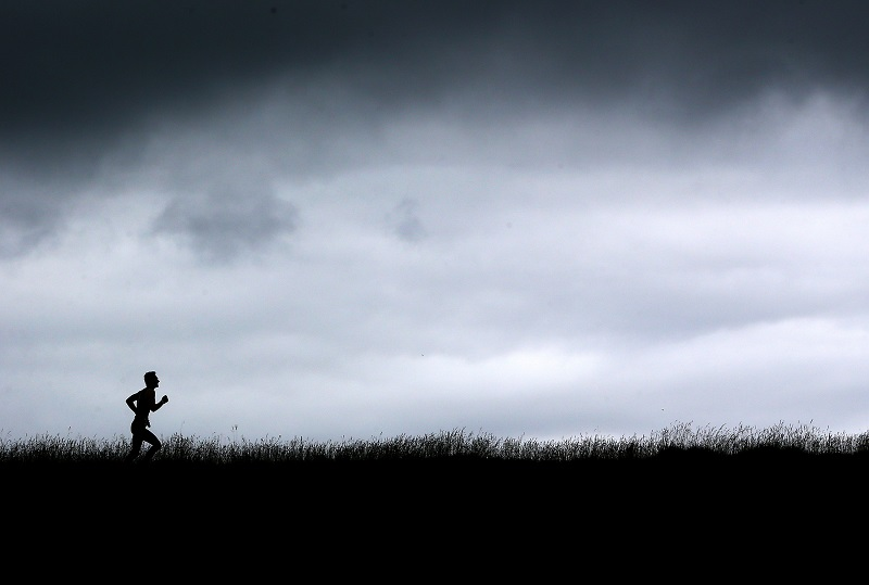 A man running through the English countryside
