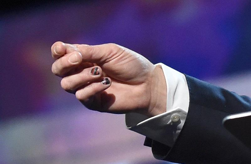 Brad Pitt's fingernails are seen as he speaks on stage
