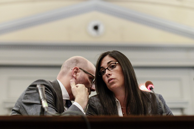 A woman listens to her attorney during a hearing | Kena Betancur/Getty Images