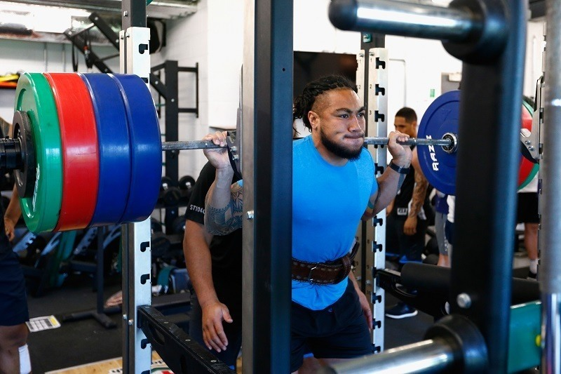 A lifter trains during a bodybuilding lifting session
