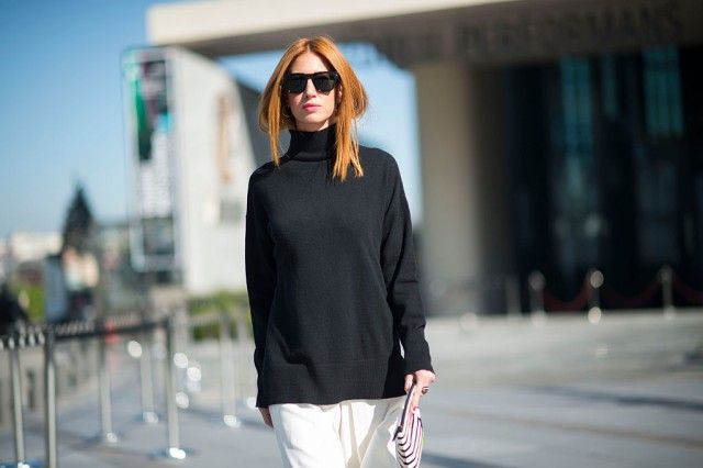 Woman with black sweatshirt and sunglasses