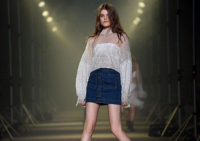 A model parades a creation from Australian label Aje during a showing of their new collection at Fashion Week Australia in Sydney on May 16, 2016. / AFP / WILLIAM WEST (Photo credit should read WILLIAM WEST/AFP/Getty Images)