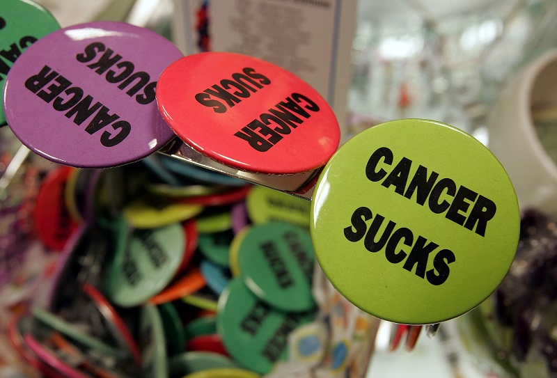 """Buttons with the words """"cancer sucks"""" are seen on display in the gift shop"""