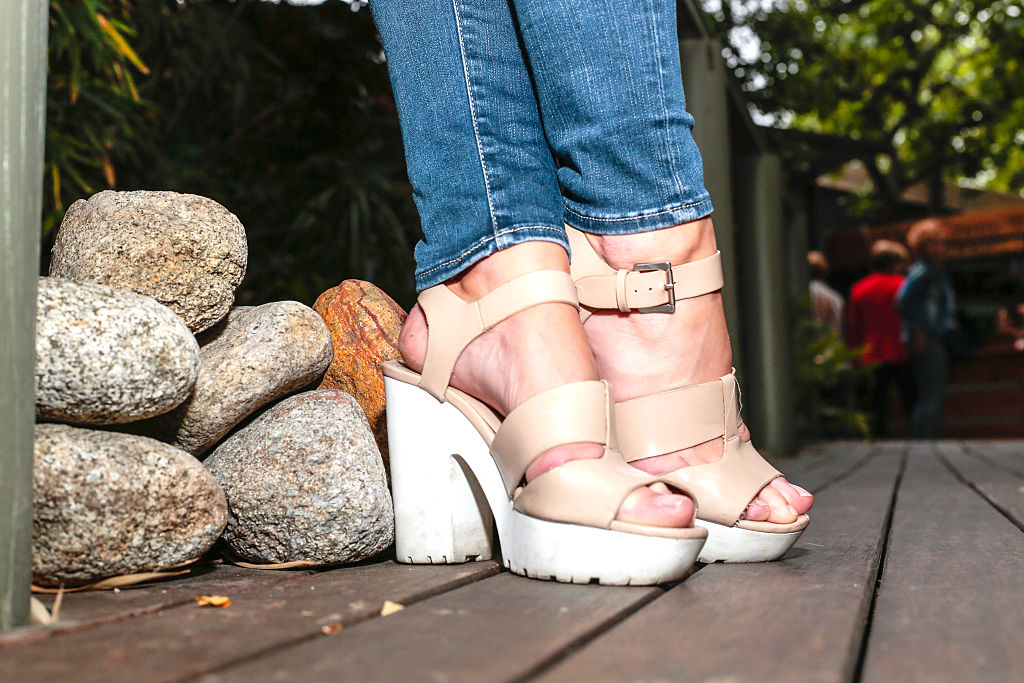 woman in high-heeled sandals