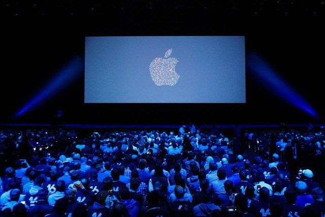 People take their seats ahead of Apple's annual Worldwide Developers Conference presentation at the Bill Graham Civic Auditorium in San Francisco, California, on June 13, 2016. / AFP / GABRIELLE LURIE (Photo credit should read GABRIELLE LURIE/AFP/Getty Images)